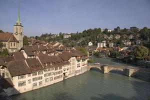 Houses line the banks of the River Aare in Bern, Switzerland, Europe.