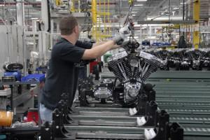 Employee at Harley-Davidson Powertrain Operations facility shipping a completed powertrain.