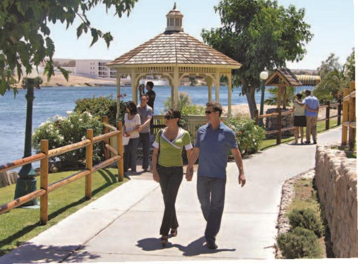 Enjoy the waterfront on a stroll along the Laughlin Riverwalk. August's Colorado River Regatta sparks the area's summer events calendar.