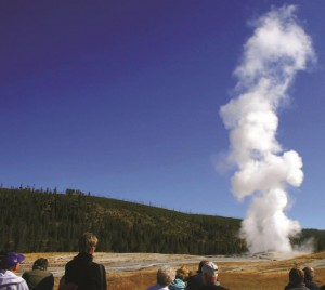 Old Faithful, one of the world's most famous geysers and a symbol of Yellowstone National Park, shoots a plume of steam every 80 to 90 minutes.