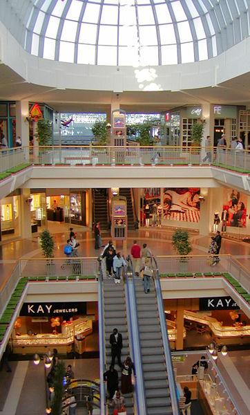 One escalator well