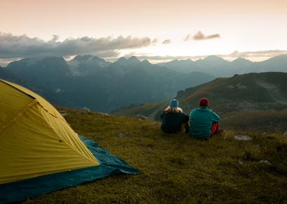 couple camping at night