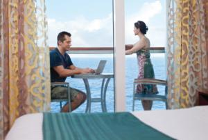 Guests using High speed Wifi on their stateroom balcony