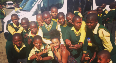 Evita Robinson enjoys Johannesburg, South Africa with a group of local children