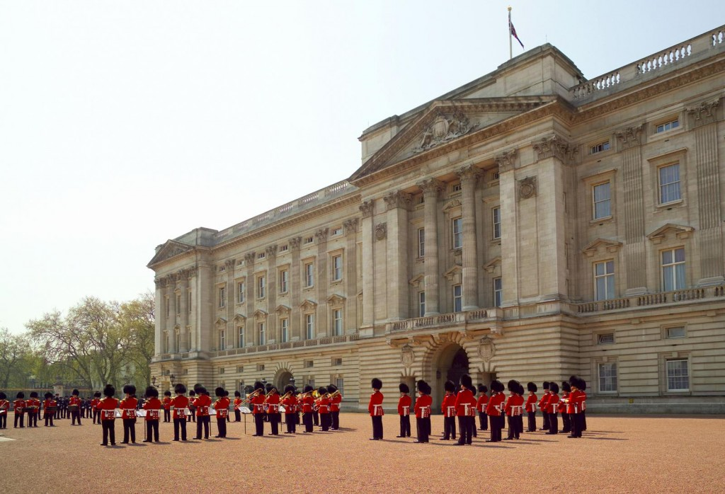 The Changing of the Guard ceremony taking place in the courtyard of Buckingham Palace