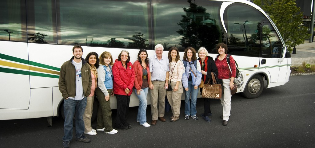 Steve Juba and group in front of tour bus