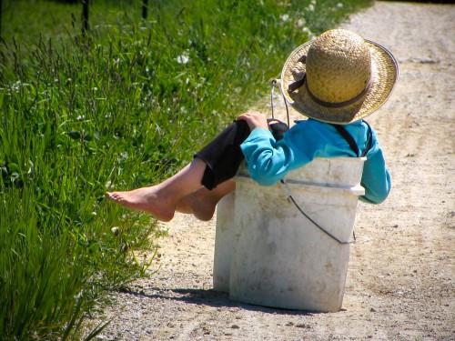 Amish boy in bucket