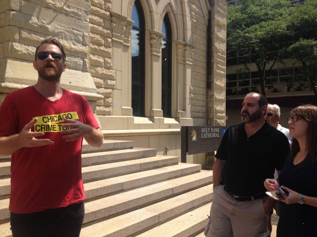 Landry explains the story behind Al Capone and Hymie Weiss' rivalry outside Holy Name Cathedral. Photo Credit: Ally Mahoney