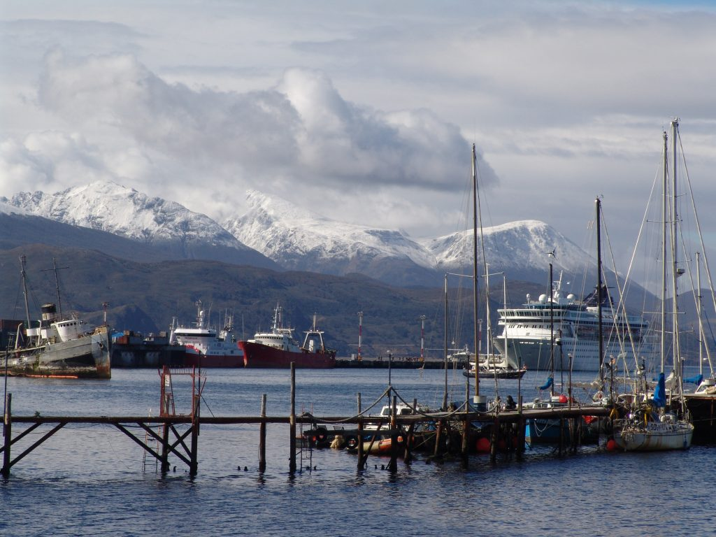Snow-capped Andes peaks overlook the Ushuaia waterfront, a popular cruise ship port.