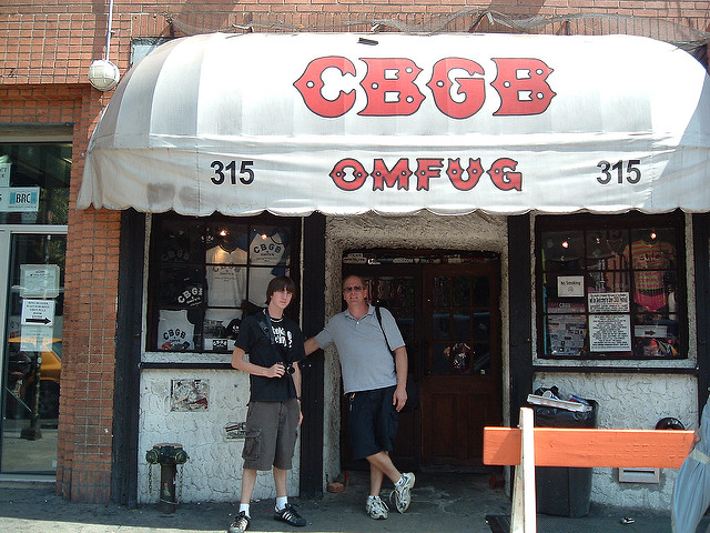 Tourists taking photos where the CBGB once stood. Photo Credit: John Blough/flickr