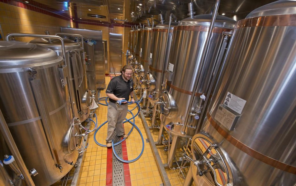 Carnival Vista Brewmaster Colin Presby Tends to the Fermentation Tanks for the Redfrog Pub and Brewery (photo courtesy of Carnival Cruise Line)