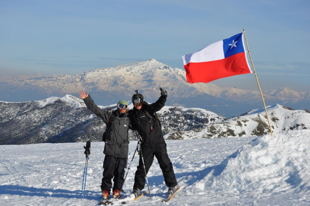 skiers by flag