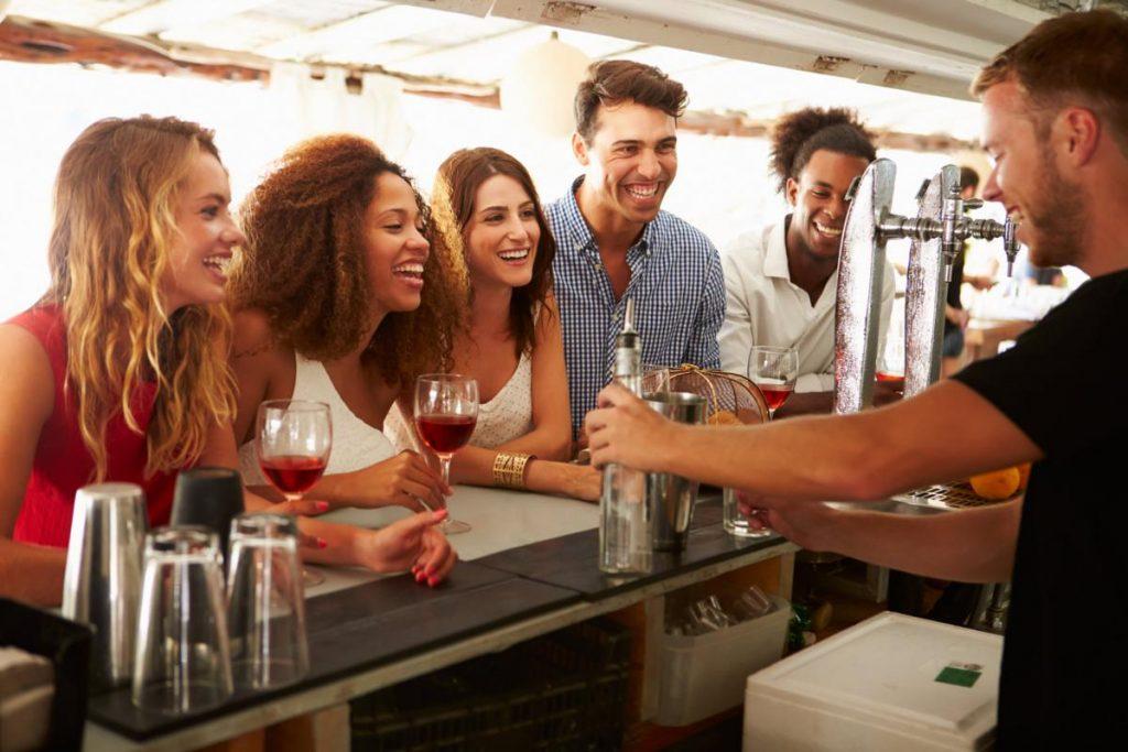 riends Enjoying Drink At Outdoor Bar