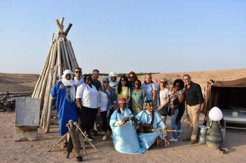 Members of tour group get a taste of local culture at Agafay Desert Luxury Camp outside of Marrakech.