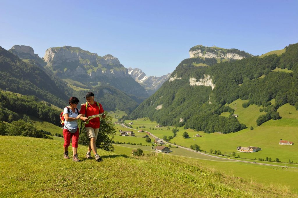 a couple hiking in switzerland