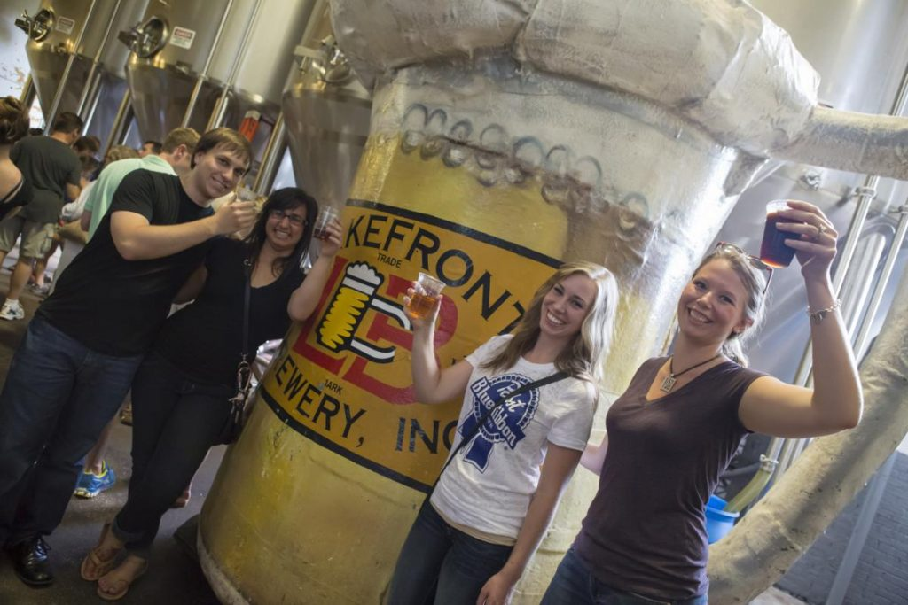 Three women and a man enjoying the Lakefront Brewery Tour.