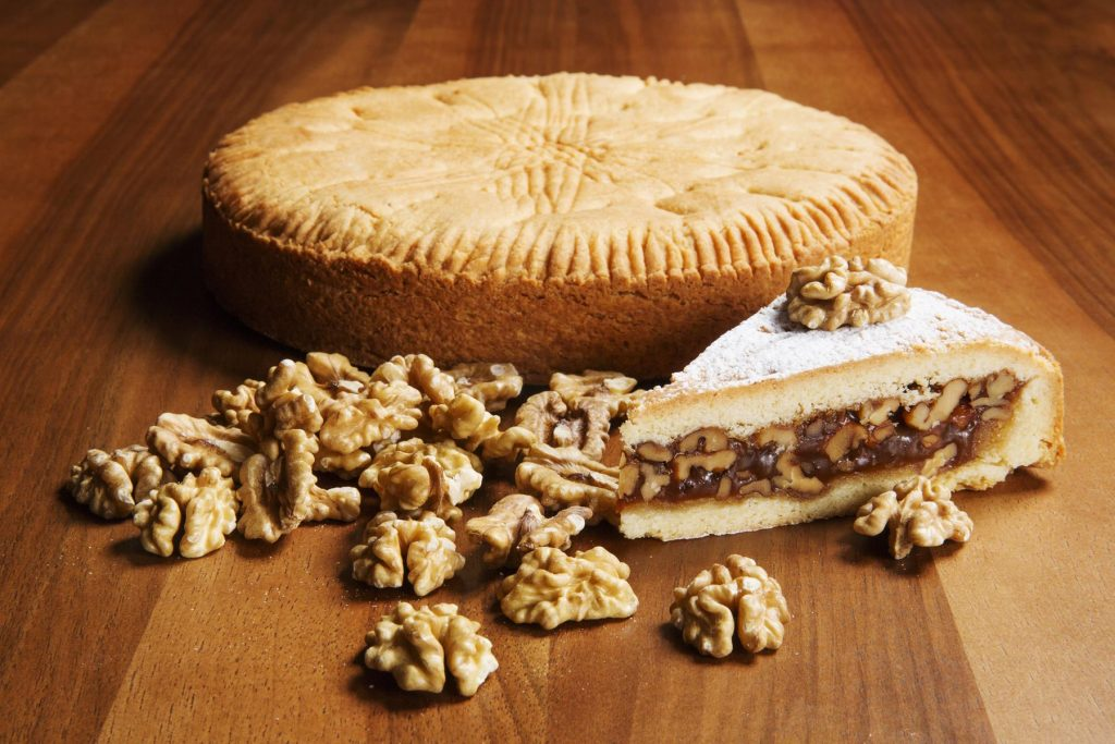 Engadiner Nusstorte (nut tart) is made from buttery pastry, creamy caramel and walnuts.