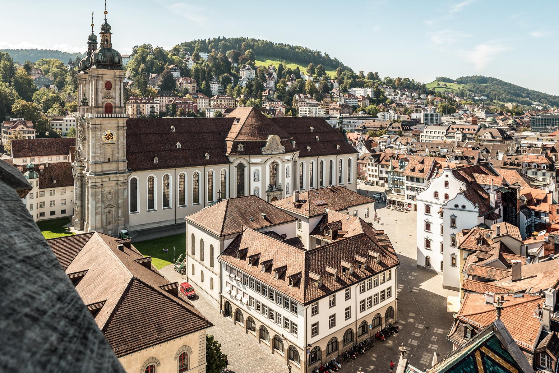 St. Gallen's twin-tower Baroque cathedral is part of its famous Abbey District. - Switzerland Tourism