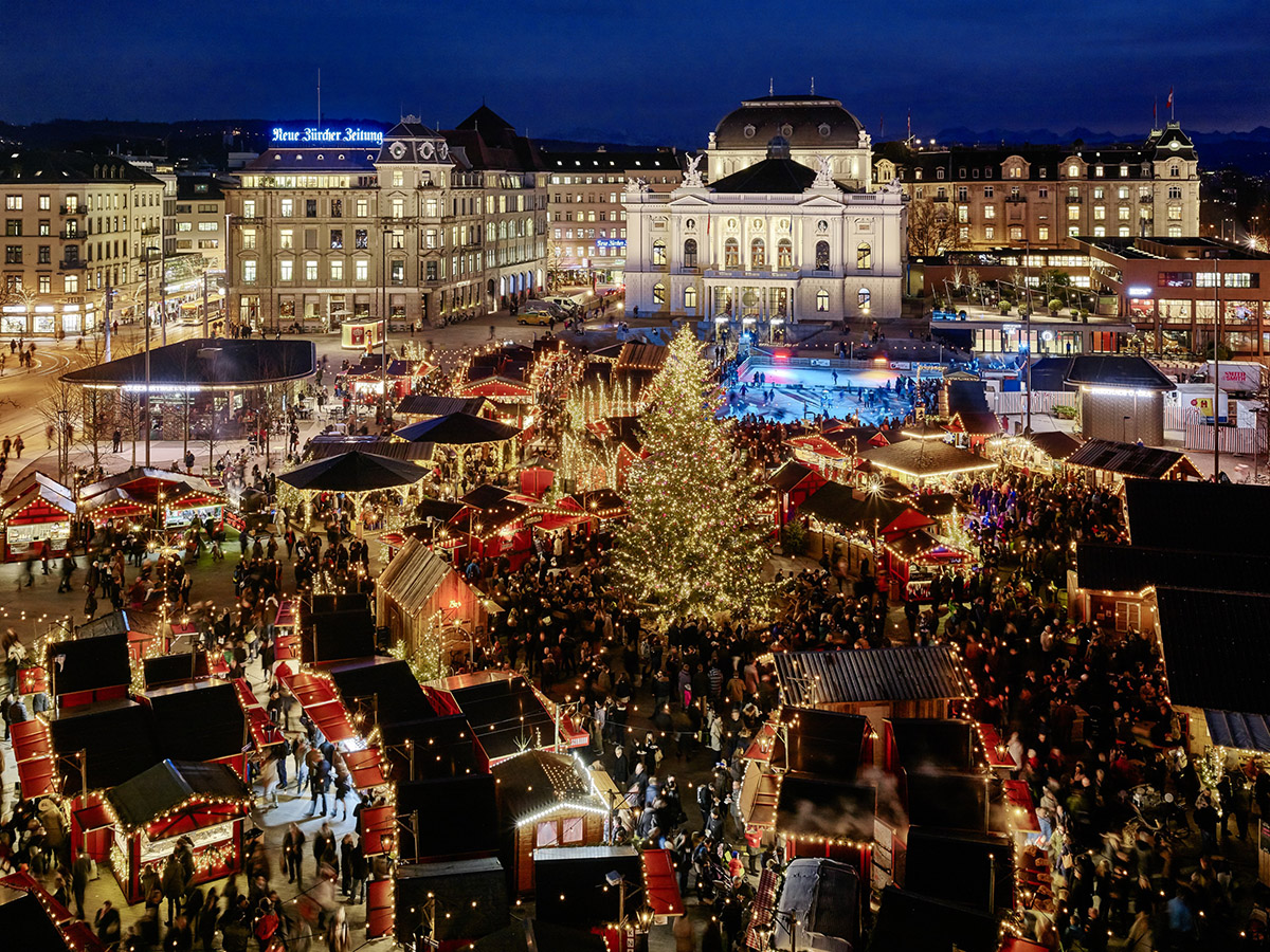 Christmas Village, with 100 market stalls and an ice rink, takes over Sechseläutenplatz in front of the Zurich Opera House. Zurich Tourism