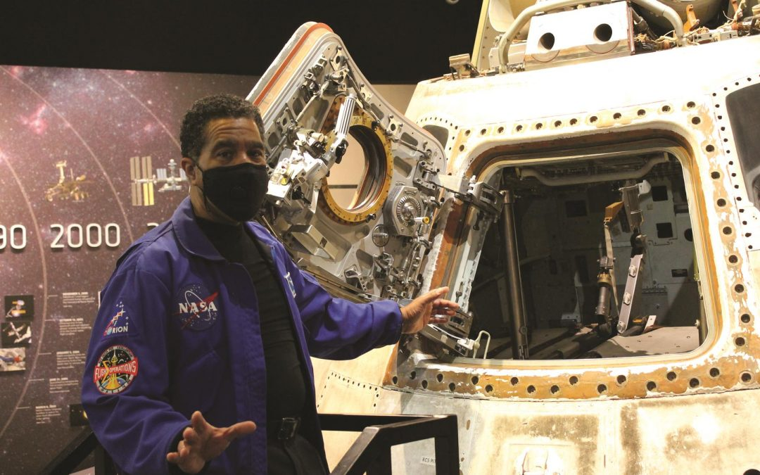 """A STEM Learning staffer, JonDarr Bradshaw, conducts a """"Capsule Chat"""" alongside the Apollo Command Module."""