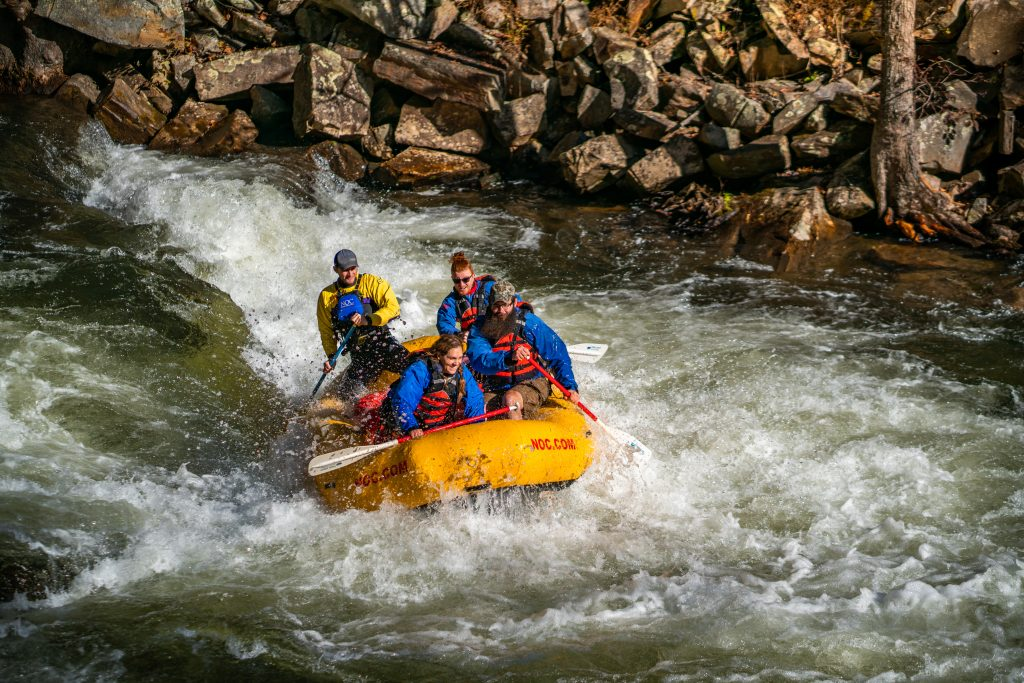 Whitewater Rafting at Nantahala Outdoor Center With Rocks In Background