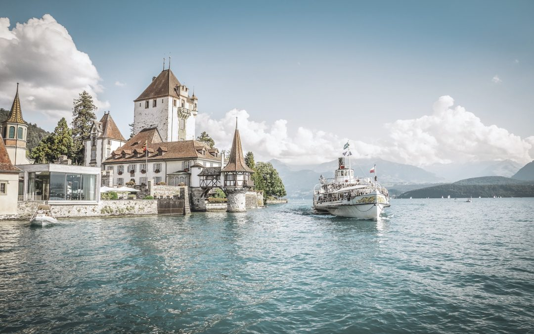 Cruises on Lake Thun offer a close-up look at 12th century Oberhofen Castle. The peaks of the Eiger, Mönch and Jungfrau form a dramatic backdrop. Switzerland Tourism
